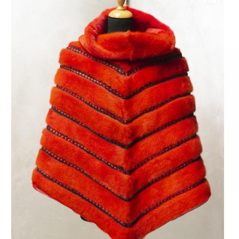 Orange mink poncho with red suede inlays black passementerie and red satin