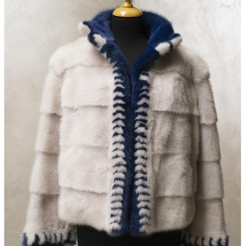 Pearl mink jacket worked horizontally with navy blue mink inlays.