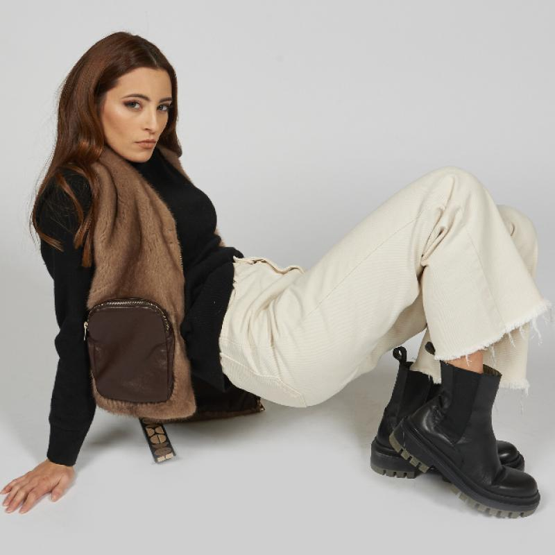 Fur vest with leather pockets